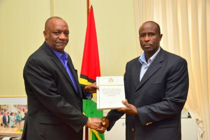 Minister of State, Mr. Joseph Harmon receiving the report from Brigadier Bruce Lovell at the Ministry of the Presidency