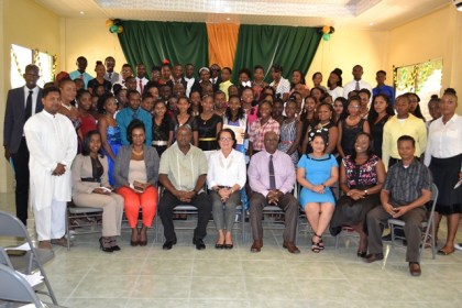 The graduates and facilitators with First Lady, Mrs. Sandra Granger at the end of the ceremony