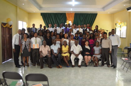 Minister within the Ministry of Education Nicolette Henry (centre) with Presidential Advisor on Youth Empowerment Aubrey Norton and the Youth Leadership Training Programme graduating class