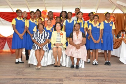 First Lady, Mrs. Sandra Granger (seated centre) and the Top Ten students and their teachers. She is flanked by, from left to right, retired Head teacher Ms. Barrow and Head Teacher, Mrs. Ademola  Osborne.