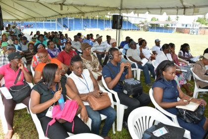 A section of the crowd of residents waiting their turn to have their issues addressed at the  Meet the Public event at the Mckenzie Sports Club Ground in Linden today.