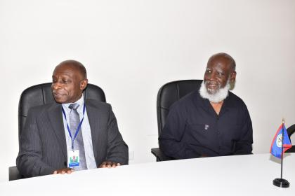 Guyana's Foreign Affairs Minister Carl Greenidge (left) and his Belizean counterpart, Wilfred Elrington