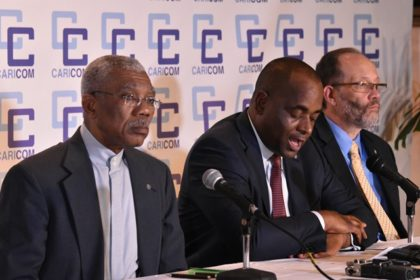 Centre: Caribbean Community Chairman, Prime Minister of Dominica, Roosevelt Skerrit at the closing ceremony of the CARICOM Heads Regular Meeting. Also in the photo are; Guyana's President, David Granger who co-hosted the Heads Conference, and Secretary General of CARICOM, Ambassador Irwin La Rocque.