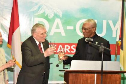 High Commissioner to Guyana, Mr. Pierre Giroux and President David Granger share a toast in celebration of 'Canada Day' as well as the 50 years of friendship between the two countries.