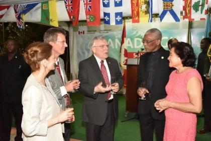 President David Granger and First Lady, Mrs. Sandra Granger in conversation with Canadian High Commissioner Mr. Pierre Giroux (at centre) and his wife Mrs. Blanca Giroux and Head of Aid, Mr. Daniel Joly on the occasion of Canada Day.