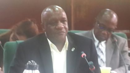 Minister of State Joseph Harmon responding to questions from the Parliamentary Sectoral Committee on Natural Resources, at Parliament Chambers