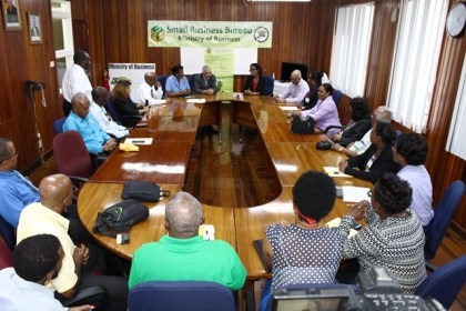 The gathering of trainers with Minister of Business and Tourism, Dominic Gaskin, Permanent Secretary, Rajdai Jagernauth and Officer in Charge of the Small Business Bureau, Gillian Edwards-Griffith at the head table