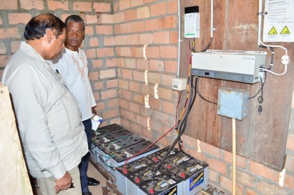Prime Minister Moses Nagamootoo and Radio Paiwomak Coordinator Virgil Harding inspecting the batteries donated by OPM.