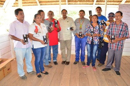 Prime Minister Moses Nagamootoo and Vice President Sydney Allicock NRDDB executives and village representatives who were presented with solar LED lights.