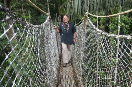 Prime Minister Moses Nagamootoo on the Iwokrama Canopy Walkway.