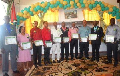 The first place winners of GuySuCo's Honour Roll Awards for outstanding work in 2015