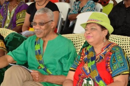 President David Granger and Minister of Social Cohesion, Ms. Amna Ally, enjoying the cultural presentation by the residents of the Ithaca village.