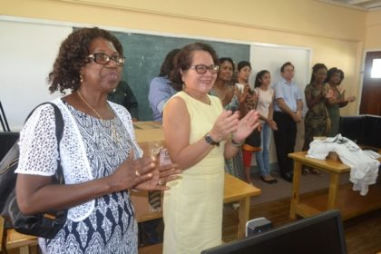 First Lady, Mrs. Sandra Granger applauds during a presentation, this morning.  Ms. Joycelyn Wilson is pictured left.