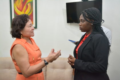 The First Lady converses with President of the Guyana Animation Network, Ms. Jubilante Cutting about her plans to develop the local animation industry