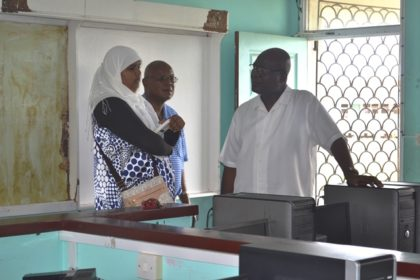 Presidential Advisor on eGovernment and Head of the eGovernment Agency, Mr. Floyd Levi (centre) and Director of the connectivity aspect of the project, Mr. Phillip Walcott listen as Dean of the IT Department of the Skeldon Line Path Secondary School, Ms. Wafeeya Razak explains some of the issues challenging the smooth running of the department.