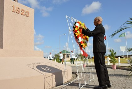 President David Granger lays a floral tribute at the Demerara Revolt Monument at Atlantic Avenue, this morning.