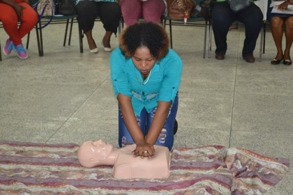One of the participants, demonstrating basic Cardiopulmonary Resuscitation (CPR).