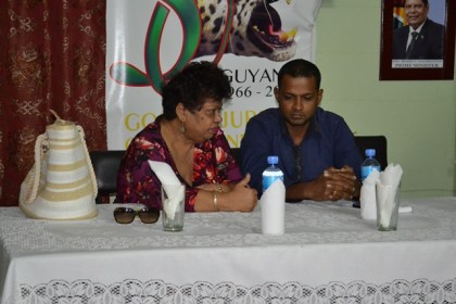 Minister of Social Cohesion, Ms. Amna Ally and Regional Chairman, Mr. Vickchand Ramphal share a quiet word at the head table.