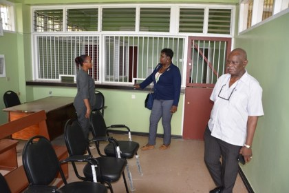 Minister of Citizenship, Mr. Winston Felix along with  Assistant National Director, Community Development Councils, Ms. Sandra Adams of Linden, examine the office within the National Insurance Scheme building  where the passport services will be conducted.