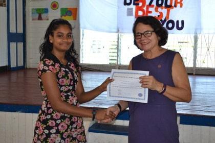 Ms. Amanda Karran accepts her certificates from First Lady, Mrs. Sandra Granger