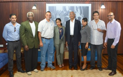 From L-R- Mr. Aditya Persaud, Mr. Godfrey Naughton, Mr. Kirk Jardine, Ms. Shazeeda Wong, President David Granger, Mr. Herandai Khemraj, Mr. Evan Radhay Persaud and Mr. Roy Mookram at the Ministry of the Presidency