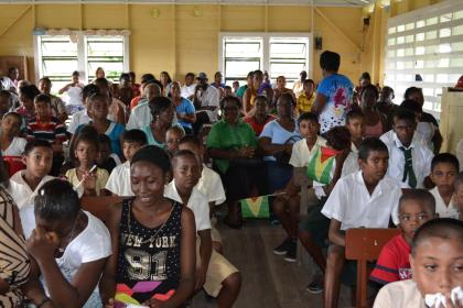 Residents of Wakenaam, who gathered at the Arthurville Primary School, in Wakenaam, Essequibo Islands-West Demerara (Region 3) to witness to distribution of bicycles under the President's Five Bs programme