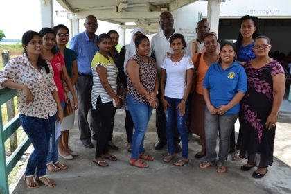 Presidential Advisor on eGovernment and Chief Executive Officer of the eGovernment Agency, Mr. Floyd Levi (back, centre) and some of the teachers of Skeldon Line Path Secondary School, including Head Mistress, Ms. Jenny O'Brien (first, right) and Mr. Phillip Walcott, (blue-checked shirt)  Director of the connectivity aspect of the project.