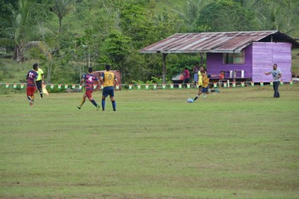 Kamarang and Waramadong football teams in action during the opening fixture of the football competition, which is the main event of the Upper Mazaruni 19th Annual District Games in Kamarang, Cuyuni Mazaruni