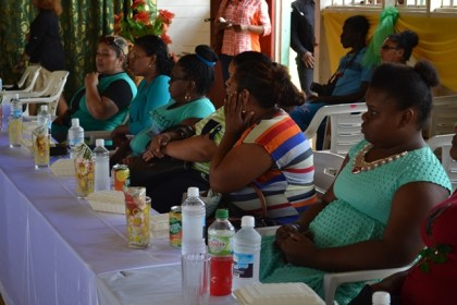 These participants pay keen attention to First Lady, Mrs. Sandra Granger as she delivers her address.