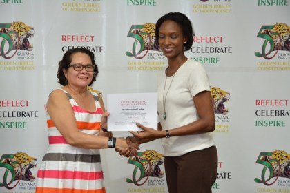 First Lady, Mrs. Sandra Granger presents a Certificate of Appreciation to a representative from Herdmanston Lodge, one of the local sponsors of the STEM workshop.