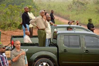 Taking in the 'Final Attack';  President David Granger and Minister of Foreign Affairs, Mr. Carl Greenidge, at the Tacama Training Area, this morning.