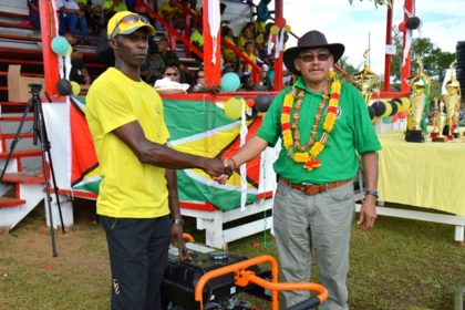 Minister of Indigenous Peoples Affairs, Mr. Sydney Allicock hands over a generator to President of the District Sports Council, Mr. Rudolph Wellington.