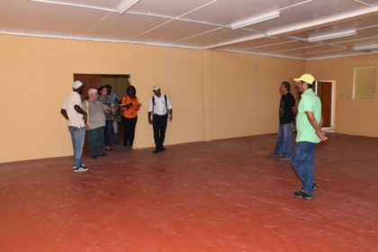 Architects and representatives of the Ministries of Education and Public Infrastructure in one of the dormitories of the Kato secondary School