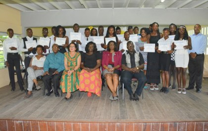 First Lady, Mrs. Sandra Granger, and facilitators, pose with the graduates from the ICT Training Programme