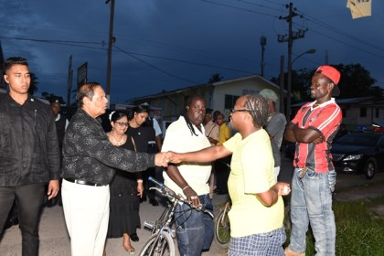 Prime Minister Moses Nagamootoo greets Linden residents during his walkabout