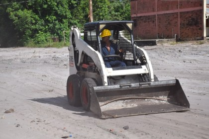 One of the young men display skills learnt during the period of heavy-duty machinery training