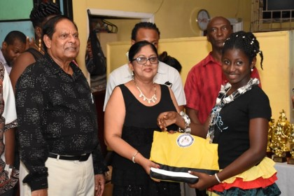 Prime Minister Moses Nagamootoo and Wife Sita Nagamootoo presents gift to one of the participants