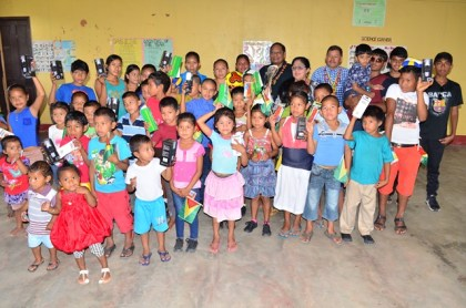 Prime Minister Moses Nagamootoo and Minister of Indigenous Peoples' Affairs Sydney Allicock with residents and children of the Fairview Community