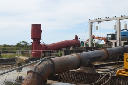 In the background – one of the non-functioning pumps to be rehabilitated at Trafalgar, Region 5