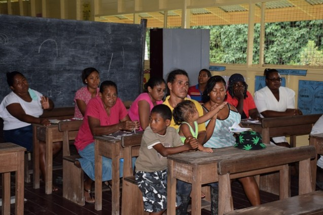 Residents of Ebini at the meeting with Minister of Social Protection, Volda Lawrence and her team