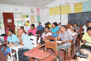 Hururu residents at meeting with Minister of Social Protection, Volda Lawrence and team