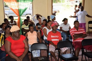 Residents of Ituni at meeting with Minister of Social Protection, Volda Lawrence and team