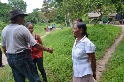 Minister of Indigenous Peoples' Affairs Sydney Allicock greeting residents of  Assakata