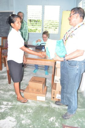 Minister of Indigenous Peoples' Affairs, Sydney Allicock presenting medical supplies to Assakata, Region One, Toshao, Sharon Aloysious