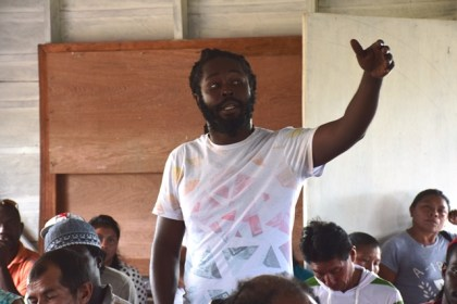 A resident of Imbaimadai raises a concern at the meeting with Minister of Natural Resources, Raphael Trotman