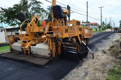 Asphalted works being carried out on the Mocha Arcadia access road, East Bank Demerara