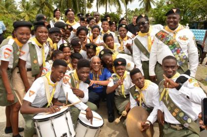 President David Granger is all smiles as he strikes a pose with a group of Seventh Day Adventist Pathfinders, who participated in the Inter-Denominational Independence and Emancipation Service, during his visit to the Den Amstel Ebenezer Congregational Church, earlier today.