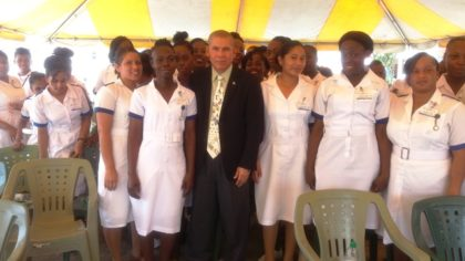 Public Health Minister Dr. George Norton along with a group of health care professionals