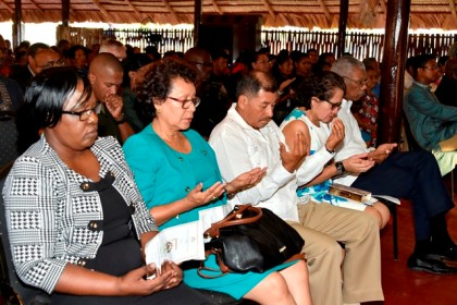 A show of reverence during the Muslim prayer- From left- Minister within the Ministry of Health, Dr. Karen Cummings, Minister within the Ministry of Indigenous People's Affairs, Ms. Valerie Garrido-Lowe, Minister of Indigenous People's Affairs, Mr. Sydney Allicock, First Lady Mrs. Sandra Granger and President David Granger.