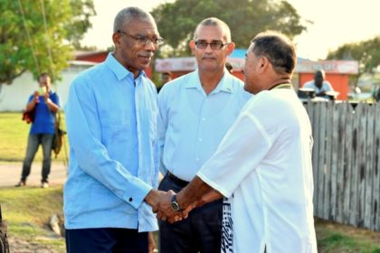 President David Granger is greeted  by Vice President and Minister of Indigenous Peoples' Affairs, Mr. Sydney Allicock upon his arrival at the National Exhibition Centre, Sophia, earlier this afternoon.